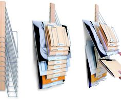 File with Style. This flexible wall mounted filing system turns file organization on it's head.  It holds items in a variety of sizes in 10 hangers. The wall mounted design frees up valuable desk space and ensures easy organization and quick retrieval.  And its wood and chrome construction gives it a sleek modern aesthetic.