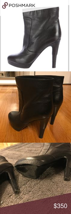 Chanel Booties Black leather ankle booties with Chanel logo stitched on top shaft of each shoe. Booties look new. Only worn once. Lightly scuffed soles are the only wear and tear on these almost new booties. CHANEL Shoes Ankle Boots & Booties