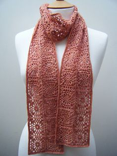 A lacy scarf made with small granny squares, joined as you go. One skein was enough to make the scarf (400m) with a 2.20mm hook. This pattern is written in english terminology.