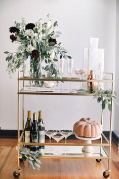 Want to add a bar cart to your home but don't know where to start? You've come to the right place! Bar carts are a huge trend that we are certainly on board with, but it can be hard to find out exactly what to add to your bar cart or how to even start… Home Bar Signs, Diy Home Bar, Modern Home Bar, Home Bar Decor, Bars For Home, Kitchen Decor, Diy Bar Cart, Bar Cart Decor, Bar Carts