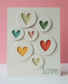 Handmade Valentine Card ... graphic look ... cut out circles with negative space hearts backed with glitter papers in bright colors ... good use for those papers that can soon overwhelm a card ...