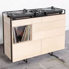 Selectors Cabinet  This DJ furniture piece is constructed with a steel frame and modular wooden cabinets. Creating a perfect balance between esthetics and functionality was the main goal. Both turntables and CDJ's will fit. Being compact and classy, the cabinet blends in perfectly with your interior. The Selectors Cabinet can be placed in for example living rooms, shops, galleries or bars. There is space to store your records in three compartments. Monitor speaker stands come with the…