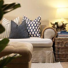 Family room detail:  Basket end table & pretty Kravet blue & white fabric pillow - Nicki Dobrzynski