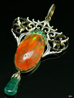 Renaissance revival fire opal pendant, by Carlo Giuliano, English, 1880. Composed of fire opal, emeralds, enamel and 18K gold. #Giuliano #RenaissanceRevival