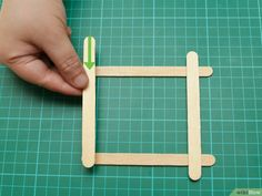 How to Build a Popsicle Stick Tower. Popsicle stick towers are a common engineering project to be assigned in school.Your assignment may have various criteria for height, weight, and number of popsicles, but this guide will give you a. Diy Wood Projects, Projects For Kids, School Projects, Engineering Projects, Wood Sticks, Wood Glue, Popsicle Sticks, Popsicles, Tower