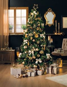 Oro, bronzo e champagne per l'albero di Natale più classico ed elegante