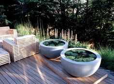 Anthony Paul Landscape Design Chairs! Also like the water garden in round planters.