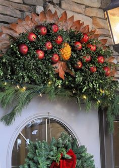 Colonial Williamsburg Christmas - I made two of these Pineapple/Apple decorations and hang them on my front porch railing on each side of my double wide brick steps during the holiday season.