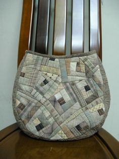 Japanese Quilted Bag. A lovely use of skewed log cabin in grey taupes.