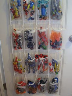 Cool DIY Toy Storage Idea - Use a clear see-through shoe bag, hang it on the back of a door in a child's room and Voila!!!  Great pockets to store small kid's toys!  | Shelterness