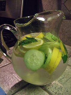 """Not sure if I could do the mint in this...    Sassy Water - {8 ½} cups water  {1} teaspoon grated ginger  {1} medium cucumber, sliced thin  {1} large lemon, sliced thin  {12} mint leaves   Put it all in a pitcher and refrigerate over night, drink the WHOLE pitcher the next day.  Helps with bloating and gently detoxes.  I love this and do it every time I need a little help feeling less """"fluffy"""" :)"""