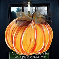 Door Hanger: Fall Pumpkin, Fall Home Decor, Pumpkin Door Decoration, Thanksgiving Decor. $42.00, via Etsy.