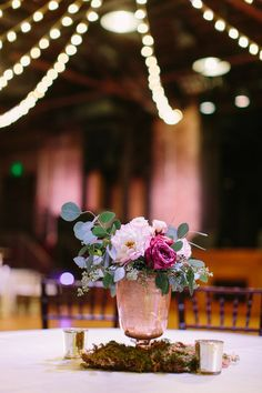Gold + pink short floral centerpiece idea - gold vases with purple + light pink flowers with greenery displayed on moss with candle votives {Al Weddings}