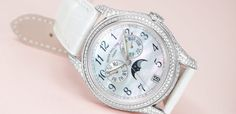 Patek Philippe Ref 4937G in white gold with a feminine mother of pearl dial and diamond-set case offers the functions of an annual calendar, all controlled by a mechanical self-wound movement visible through the sapphire glass case back.