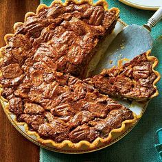 Chocolate-Caramel Pecan Pie | This decadent pie pairs perfectly with a dollop of whipped cream or a scoop of vanilla ice cream. | SouthernLiving.com