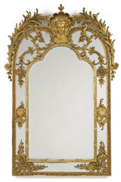 A Régence style carved giltwood mirror late 19th century height 70 1/2 in.; width 48 1/2 in.