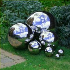 Use mirror glass spray paint on assorted size balls.