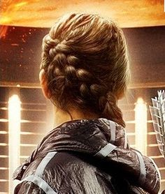 Mom! I need a Katniss braid for the premiere of Catching Fire. Zoe wants one too, but we all no that's not going to happen.