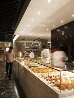 The design of a boutique bakery in a Sydney shopping mall reflects the luxury of the pastries which it sells. With just 100-sq-m to work with, the priority for designer Mark McConnell was naturally the kitchen space. Equipped with two ovens, proofer, pastry benches, mixers and a cooling room, the kitchen can be seen from the storefront and mall hall. 'The retail display was to be very simple to allow a broad layout of the various pastries and breads the French bakers were preparing in the…