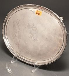 English silver oval footed tray, George Heming and William Chawner, London, 1780-1 with beaded edge and molded leaves on the feet; engraved crest depicting a standing lion, beneath a crown; 1 3/8 in. H., 8 X 10 5/8 in., 16.8 ozt.