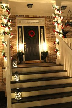 Christmas Front Door.....love the lights in the lanterns on the steps!  I want this front porch omg