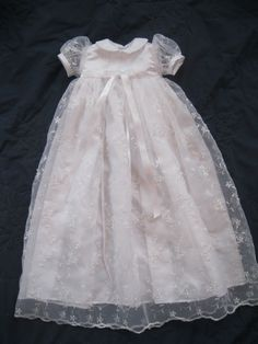 Could do something like this idea - lace over lay with simple button up he back dress pattern for Ella's baptism dress. Under dress light cotton - not sleeve - over dress light lace with cap sleeve.
