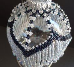 Victorian Swag Christmas Tree Ornament cover is made with midnight blue and ice blue seed beads with clear crystal-like drop beads along the bottom fringe. It it removable and fits over any 10 1/2 inch ornament.