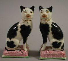 Probably not authentic but love this pair of Staffordshire-style Seated Cats who care there so cute