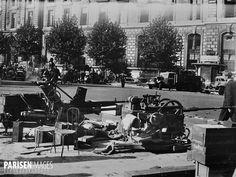 Guerre 1939-1945. Libération de Paris. Canons et matériel pris aux Allemands place de la République. 25 août 1944.