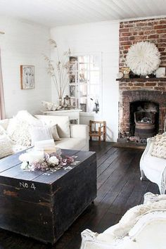An exposed brick wall adds a cozy atmosphere to an already rustic room.