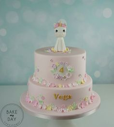 Unicorn pink tiered birthday cake with flowers