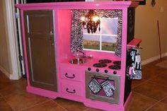 play kitchen from entertainment center -- maybe not so PINK!?