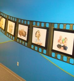 What a cute idea for a family picture wall or posters in a game room. Design by Wow! PlaySpaces