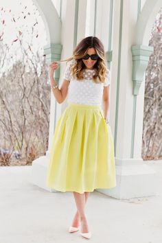 Lemon Drop - Stephanie wearing 424 Fifth Top and Skirt and Manolo Blahnik Shoes.