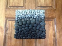 Black to gray ombre wall hanging.