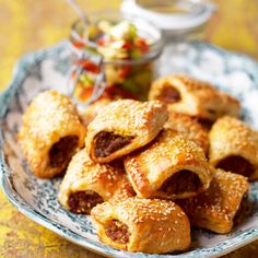 Coronation lamb rolls with piccalilli vegetables  Sausage rolls are the ultimate picnic treat or lunchbox filler, and this tasty twist on the classic recipe is deliciously succulent.