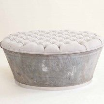 Old rusty galvanized tub is REpurposed as a gorgeous ottoman. With a polished stainless steel recessed base, timber reinforced internal frame and a perfectly finished natural raw linen upholstered top with deep button and piping detail.