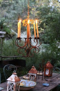 Outdoor Entertaining Area with Long Wood Table & Candlelier