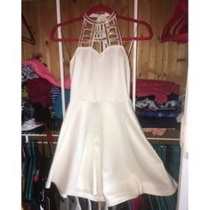 White halter skater dress from Charlotte Russe White halter skater dress with gold neckline detail. Ties in the back Charlotte Russe Dresses Mini