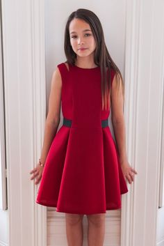 Embrace the magical festive season in our claret red and black holiday gown. Exclusively yours, the wait is over to find that perfect party dress. Now you can grant your little style icon with a dreamy new outfit to see her through the holidays, a piece to treasure always. This designer dress is available in a vibrant claret red colourway with black elastic waist and zip panels for a hint of polished contrast. A sophisticated A-line silhouette is the order of the day, while panel pleats and…