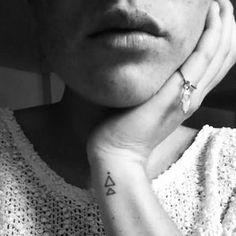 Amazing Triangle Tattoo On Left Wrist