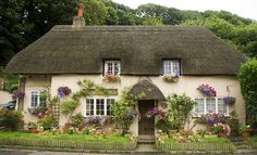 A Chocolate Box Cottage. (pretty in a conventional or idealized way: origin is from the use of attractive images to decorate boxes of chocolates).