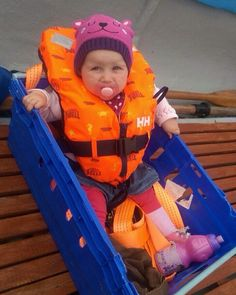 Great car seat with orange baby life vest.....and what an adorable bear hat!  Photo from @ mummy2bb Instagram