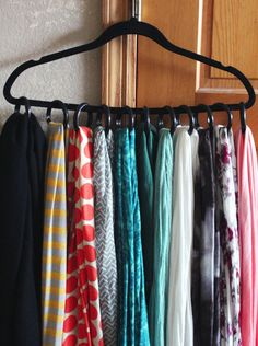 All you need to organize your scarves is a padded hanger and shower curtain rings...