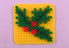 Perler Bead holly Christmas fun with Perler Beads! Check out these 10 Easy Christmas Perler Bead patterns. Melty Bead Patterns, Pearler Bead Patterns, Perler Patterns, Beading Patterns, Bracelet Patterns, Loom Patterns, Jewelry Patterns, Beading Tutorials, Crochet Patterns