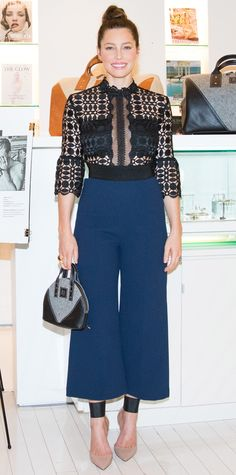 Jessica Biel made her first red carpet appearance since giving birth and was absolutely breathtaking at the Bareitall + Bare launch event in a sexy '70s-style black lace Self-Portrait one-piece with a navy wide-leg culotte silhouette. The finishing touches? A mini top-handle Bare bag and nude pumps.