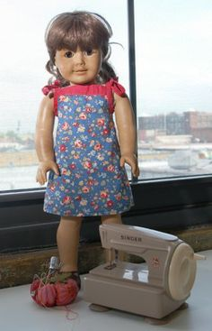 make a dress to fit my daughter's American Girl doll... free pattern!