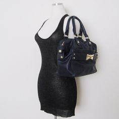 """Prettyships Navy Purse Handbag Prettyships Navy Handbag. Pre-owned in very good condition. Has a MINOR melted glue trim near the zipper but not that noticeable (last photo).Please see pictures carefully before buying. You will get exactly as pictured. Photos shown are the closest true color. Sold as is! Dimensions: 10""""H x 18""""W x 5.5""""D, strap drop 6"""" ❌SWAP❌TRADE ✔️15% OFF on Bundles. Reasonable offers are welcome. All sales are final. Thanks for looking! Prettyships Bags Shoulder Bags"""