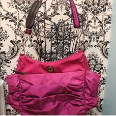 Lululemon Ombré Gym Bag Gorgeous pink/purple ombré color with pleats. Holds a yoga mat & has pockets for sweaty clothes. Adjustable shoulder strap, can be worn cross body or over the shoulder. This bag is very rare & hard to find. Tons of pockets, 2 on each side several on the interior and a large pocket in front of bag. Bag is EUC but does show some water marks on bottom of bag that are not noticeable. A small makeup stain in interior pocket again this can't be seen. Heavy duty, machine…