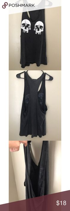 Distressed Black Skulls Tank Good used condition. Holes came with tank, for a distressed look. Great to use with a Bralette under. Sized medium, but runs big so it can fit Oversized for a small or even be worn as a size L. Color is a washed black. Tops Tank Tops
